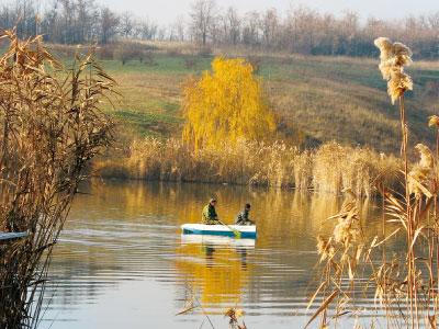 На лодке в поисках подранка.