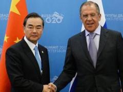 Глава МИД Китая заявил Лаврову о необходимости четырёхсторонних переговоров