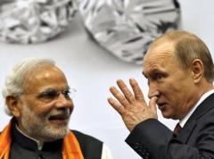 Путин накормил премьера Индии шишками и веточками