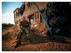 """Мужчины на войне: фото из авдеевской """"промки"""""""
