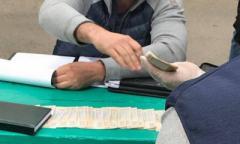 Эстафета взяток среди глав РГА: еще один пойман