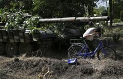 В ОБСЕ подсчитали, сколько танков и гаубиц разместили террористы за линией разграничения на Донбассе