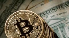 Курс Bitcoin впервые превысил 6000 долларов