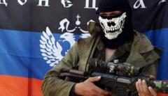Боевик «ДНР» с гранатой и оружием пытался ограбить магазин