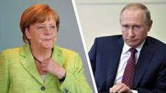 Перед встречей с Порошенко Меркель поговорила с Путиным
