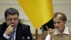 Тимошенко считает, что Порошенко может ввести военное положение, чтобы отменить выборы