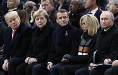 Стало известно, о чем Трамп говорил с Макроном, Меркель и Путиным в Париже