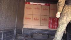 В ОРЛО члены НВФ изъяли у «контрабандистов» три грузовых авто и 32,5 тыс. пачки сигарет