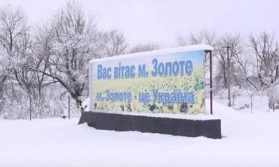 Первый снег на КПВВ «Золотое»: обстрелы с утра и новый памятник