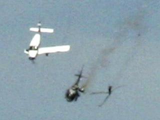 Найдены семь тел жертв столкновения самолета и вертолета